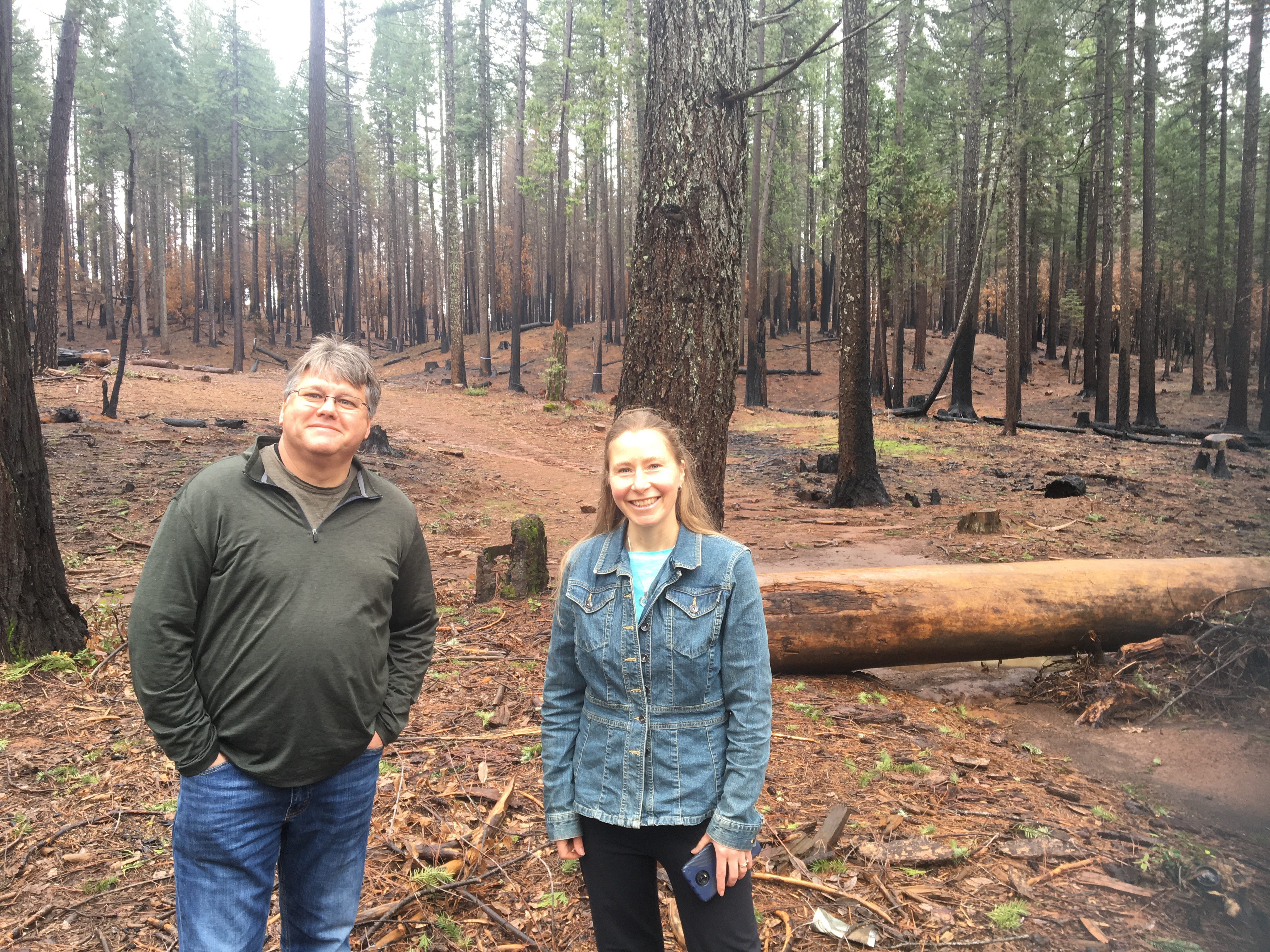 Caption: Jim Hautman and Calli-Jane showing an open forest burn scar