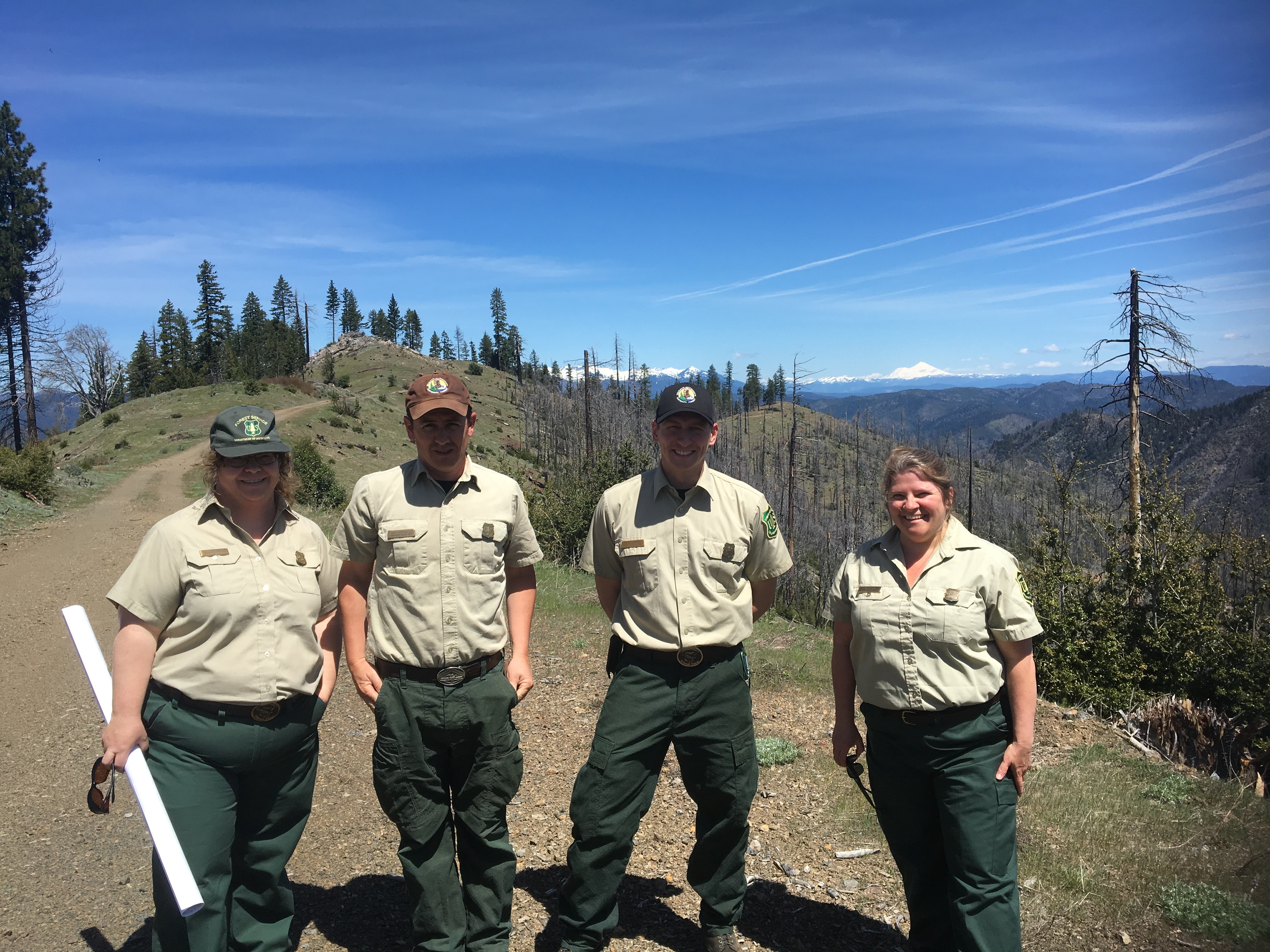 Caption: Shasta-Trinity Forest Rangers Randy Paris, Dan Ostermann, Kevin Osbourne and Carol Underhill