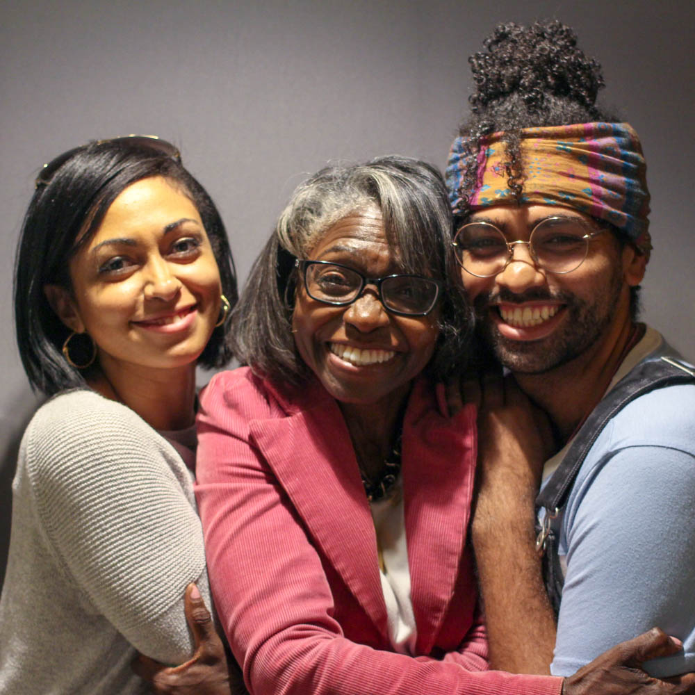 Caption: Denise Baken (center) with her children Christian Yingling (left) and Richard Yingling (right) at their StoryCorps interview in Baltimore, MD on August 23, 2019., Credit: By Emilyn Sosa for StoryCorps.