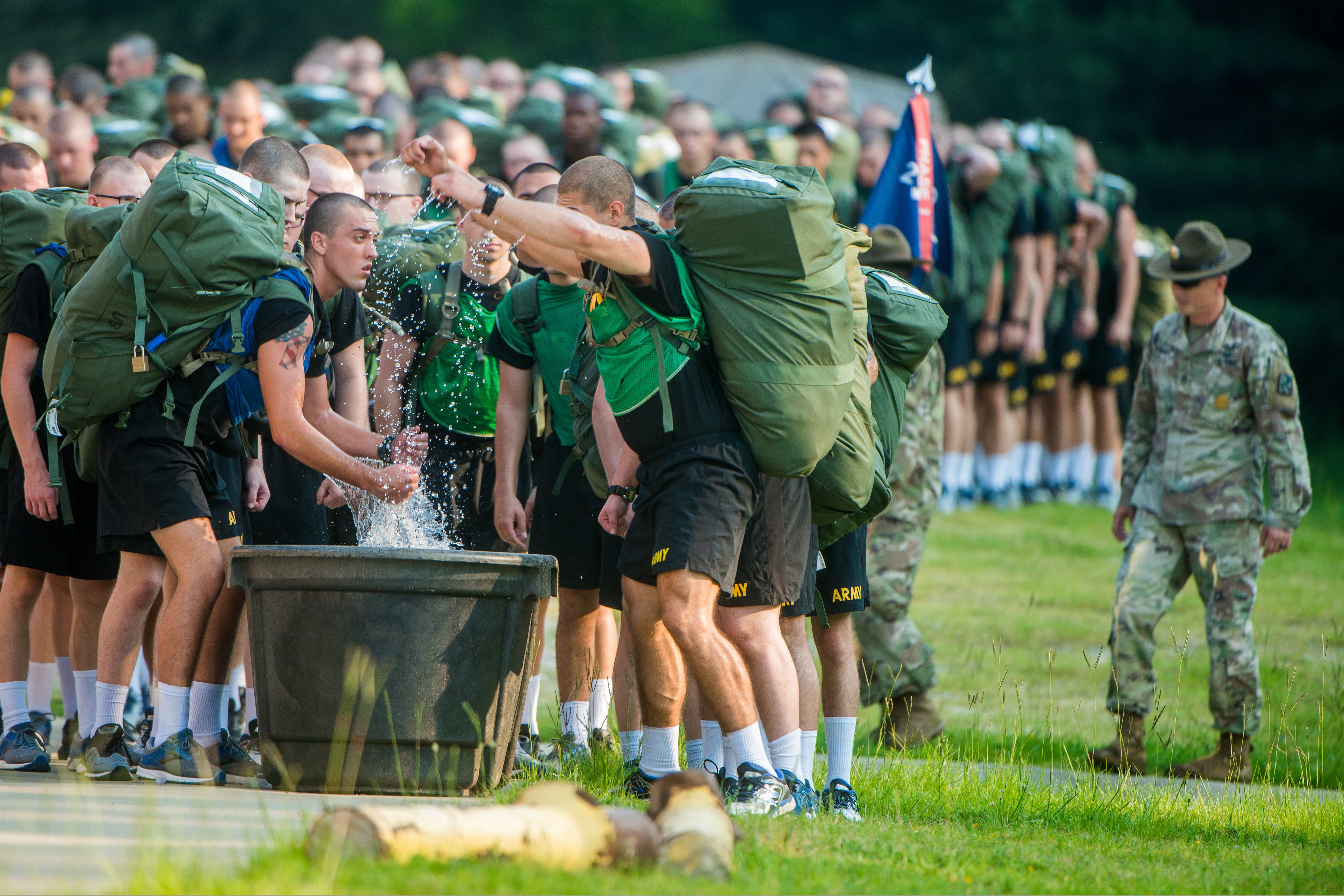 Caption: Soldiers at Fort Benning, Ga. use immersion troughs filled with ice and water to cool off during training in this 2018 photo., Credit:  Patrick A. Albright / U.S. Army