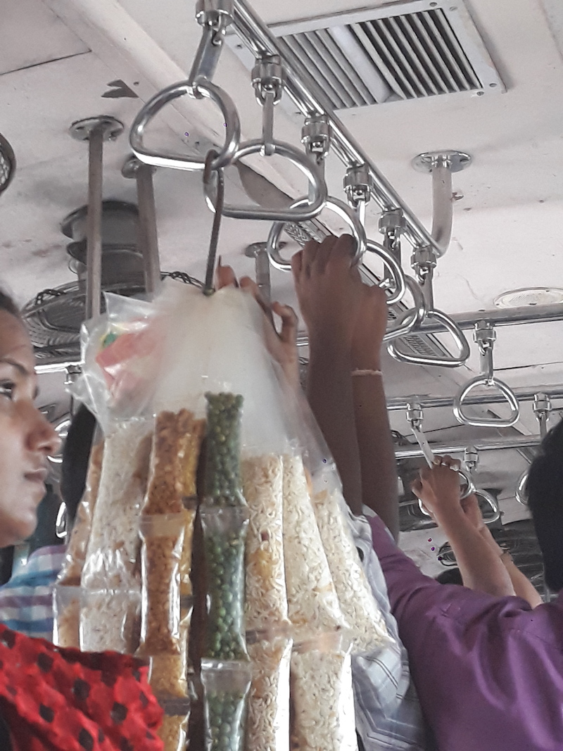 Caption: Snacks on a local train, Credit: Sandip Roy