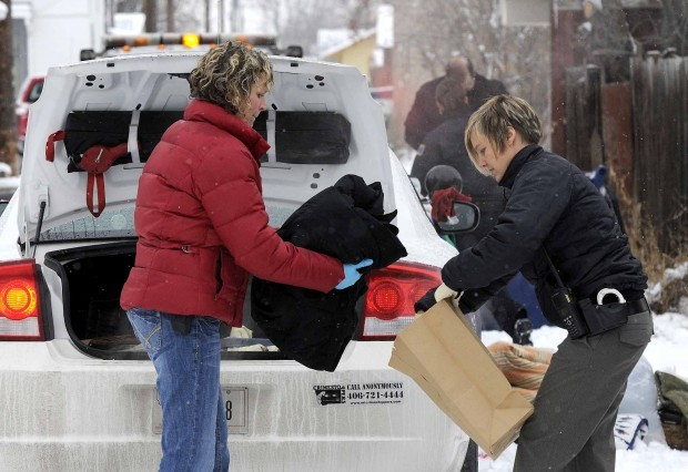 Caption: Jamie Merifield, left, collects evidence on the job in Montana.