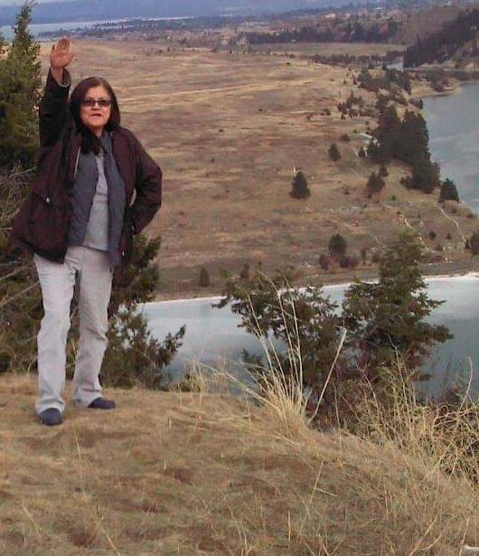 Caption: Monica Caye with a custom gesture near Flathead Lake