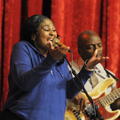 Caption: BB King's daughter Claudette King on the WoodSongs Stage.