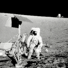 Caption: Pete Conrad of the Apollo 12 mission next to the Surveyor 3 robotic lander on the Moon., Credit: NASA