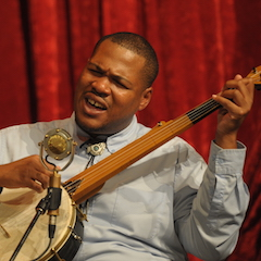 "Caption: Jerron ""Blind Boy"" Paxton on the WoodSongs Stage."