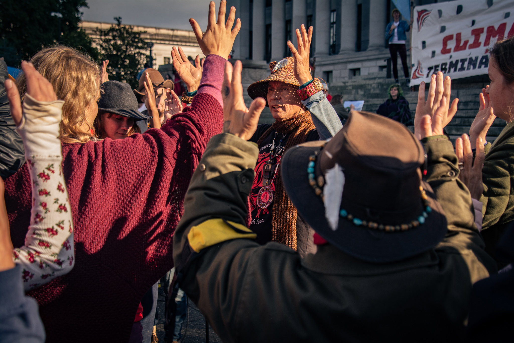 Caption: Indigenous leader Paul Che-Oke-tan Wagner (Vancouver Island Saanis), founder of Protectors of the Salish Sea, speaking at a rally on the steps of the Washington State Capitol (Olympia), October 5, 2019, Credit: Barbara Bernstein