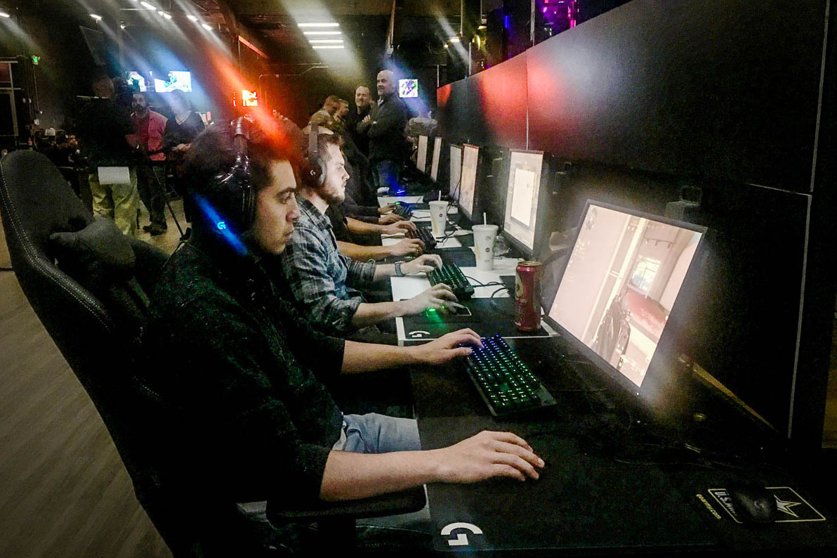 Caption: Andrew Garcia, 22, plays 'Call of Duty: Modern Warfare' at the Localhost Denver Arena during an October Army recruiting event., Credit: Taylor Allen / Colorado Public Radio