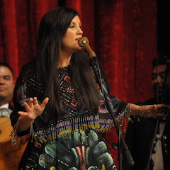 Caption: Stephanie Urbina Jones on the WoodSongs Stage.