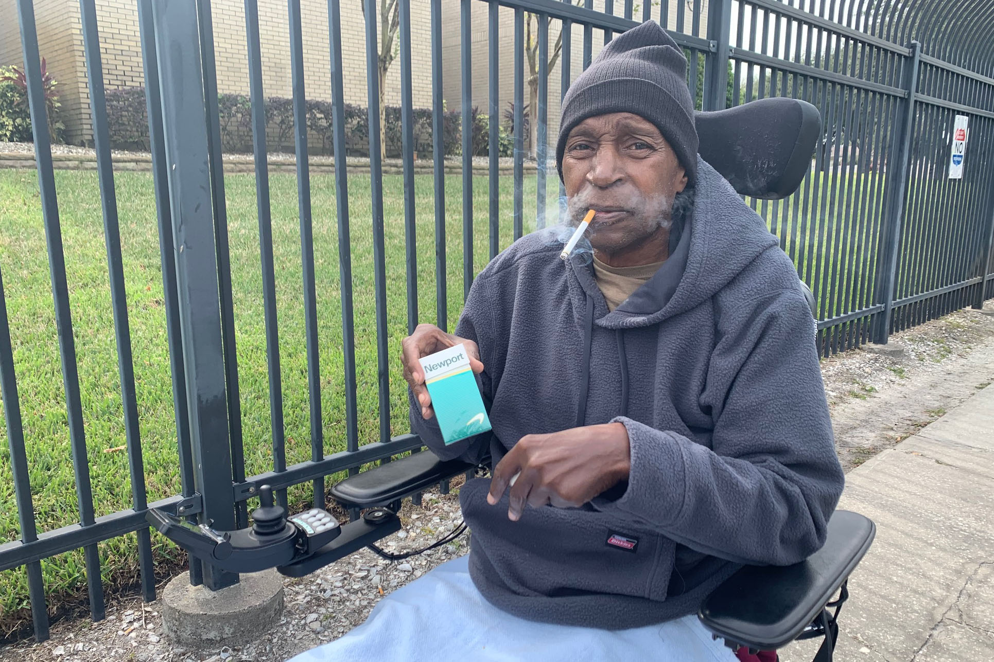 Caption: Air Force veteran Ronald West, 70, said he leaves his hospital room several times a day to smoke outside the Tampa VA property., Credit: Stephanie Colombini/American Homefront