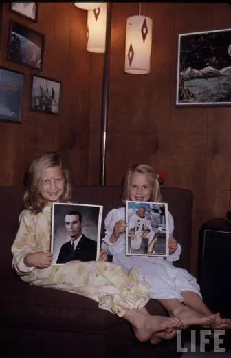 Caption:  A pic from Amy's blog of Tracy Cernan and Amy Bean when they were kids holding pics of their Apollo astronaut Dads Gene and Alan.