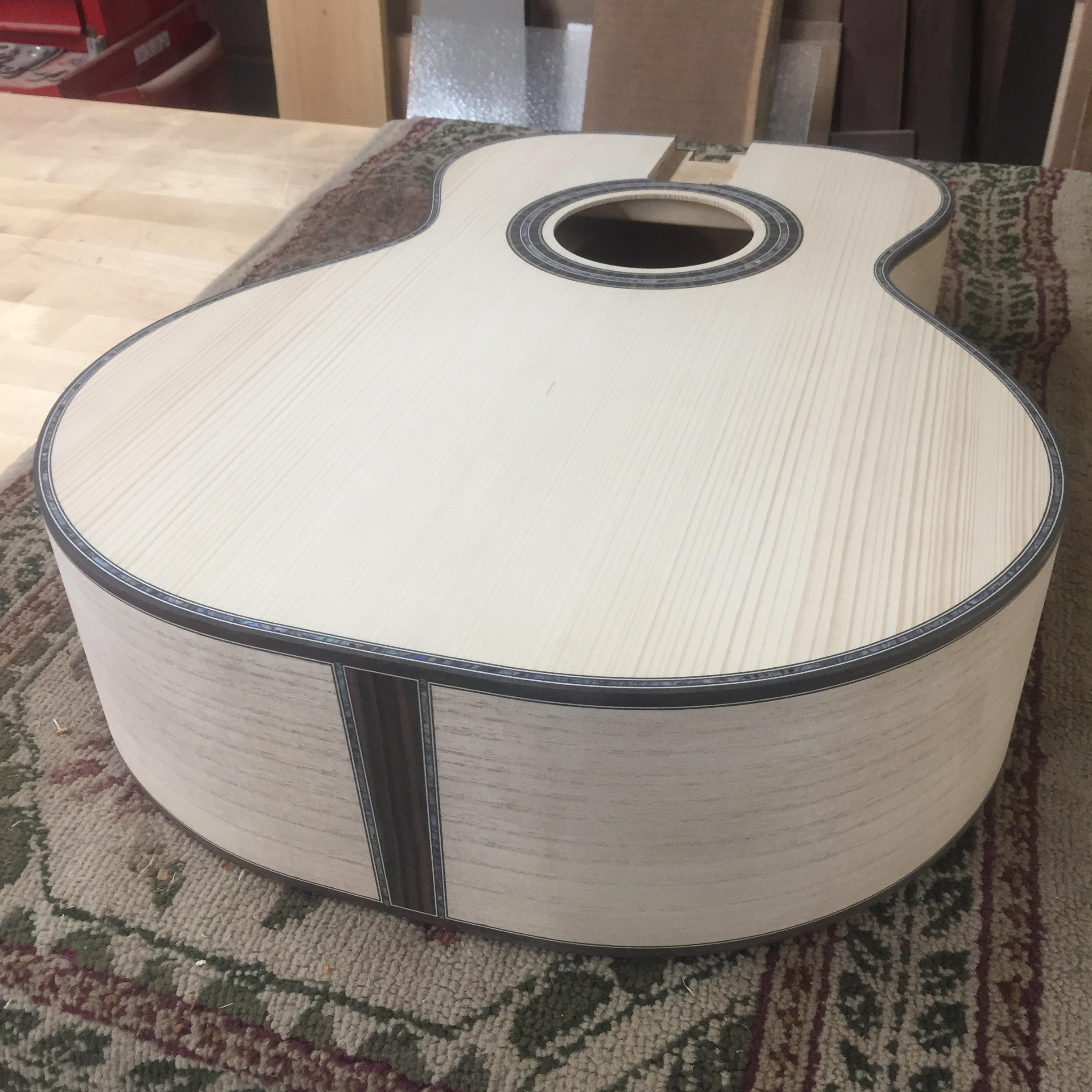 Caption: Guitar made with powlownia wood