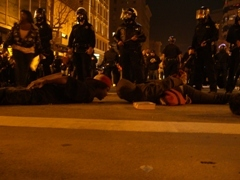 Caption: Oakland protestors lay in the position Oscar Grant was in when he was killed, Credit: Andrew Stelzer