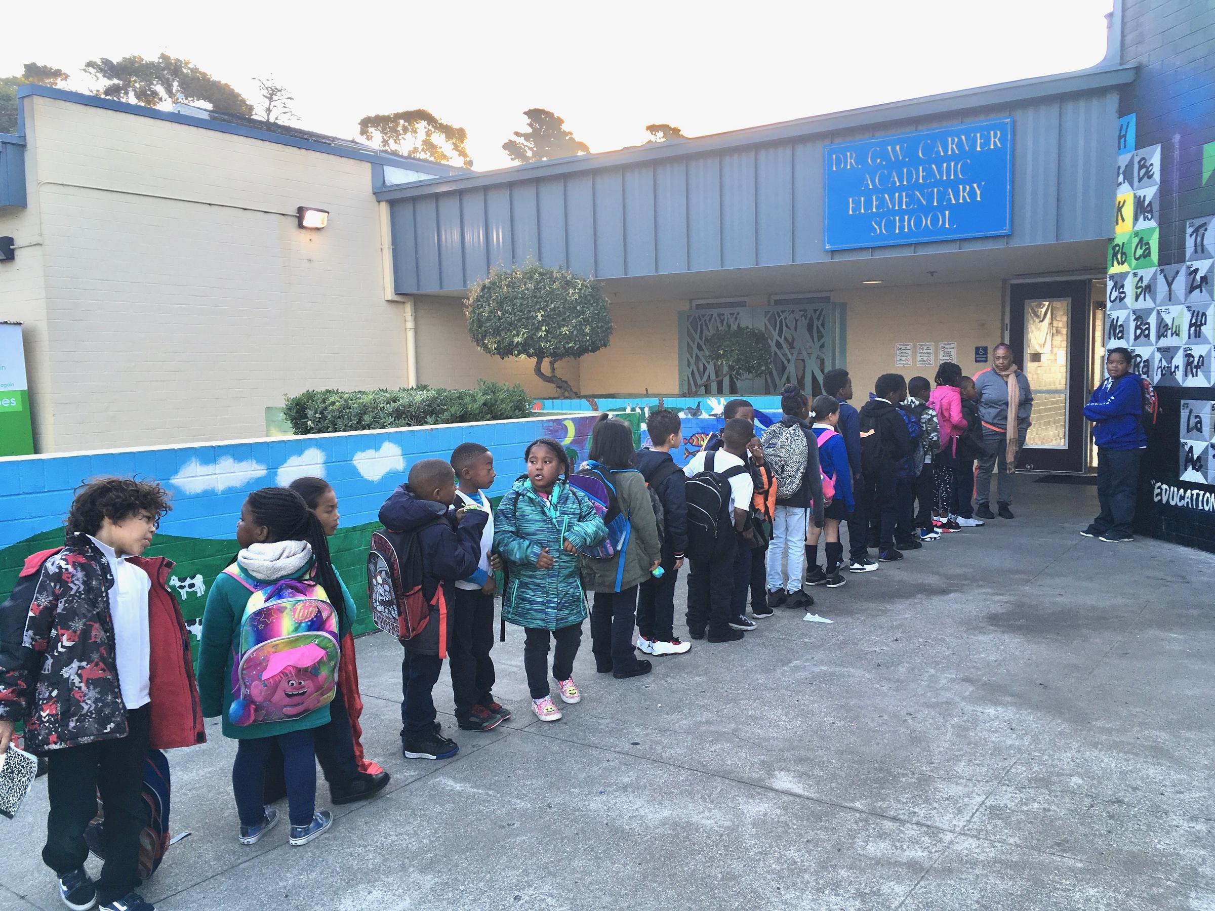 Caption: Carver Elementary students line up to begin the school day at the campus in San Francisco's Bayview district., Credit: Lee Romney / KALW
