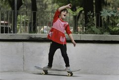 Caption: An Afghan girl practices skateboarding in a park in Kabul, Afghanistan., Credit: Photo courtesy of Associated Press.