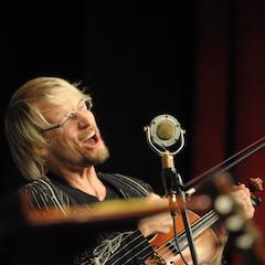 "Caption: ""Oklahoma's Musical Ambassador"" Kyle Dillingham on the WoodSongs Stage."