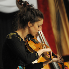 Caption: Brittany Haas from Hawktail on the WoodSongs Stage.
