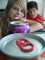Caption: Co-host Michelle Dutro and fellow intern Beno Picciano peer down a row of Wired energy drinks., Credit: Bryce Ellis