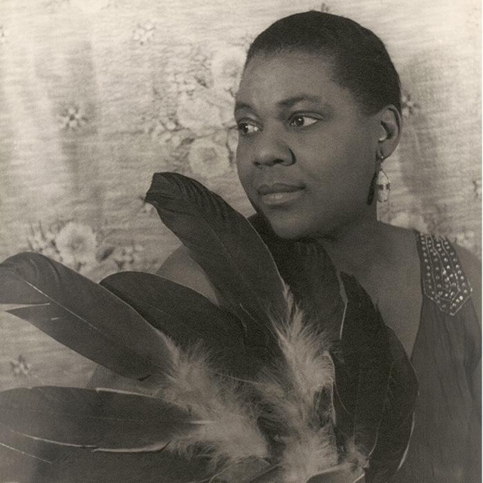 Caption: Bessie Smith , Credit: Carl Van Vechten, restored by Adam Cuerden