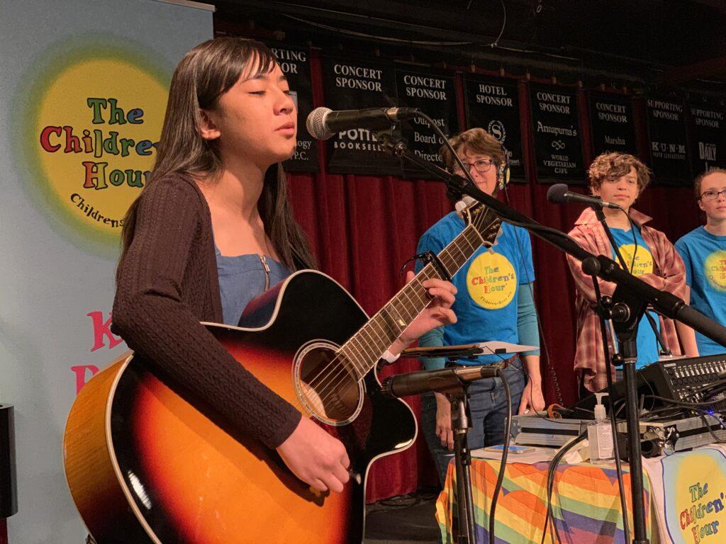 Caption: Julia Megofna performing on The Children's Hour, Credit: Andrew Stone