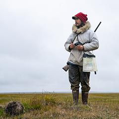 Caption: Vebjørn Aishana Reitan, polar bear guide and certified U.S. Coast Guard captain, on the refuge., Credit: Nick Mott