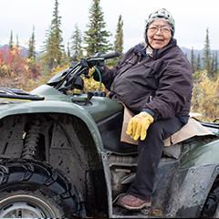 Caption: Sarah James on her four-wheeler in Arctic Village, Alaska, Credit: Amy Martin