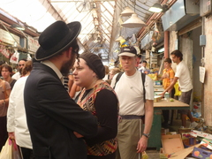 Caption: People of all stripes gather in Jerusalem to shop before Shabbat, Credit: Laura Spero
