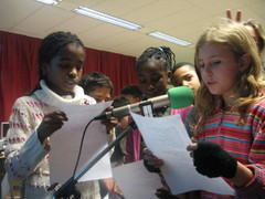 Caption: Richton Park school kids in Chicago interviewing Berlin Kids live