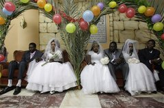Caption: Sudanese couples waiting to get married., Credit: Associated Press