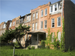 Caption:  Historic rail worker rowhouses in Chicago's Pullman neighborhood. The one on the right is boarded up and in foreclosure., Credit: WBEZ/Ashley Gross