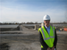Caption: Exelon's Tom O'Neill stands in front of a fleet of solar panels., Credit: (WBEZ/Gabriel Spitzer)