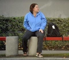 Caption: A homeless Iraq war veteran waits for a bus in California., Credit: Associated Press