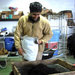 Caption: Sunil Patel Sifts Compost, Credit: Emily Reddy