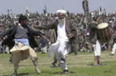 Caption: Men dance during the celebration of the Nowruz holiday in Kabul., Credit: Associated Press