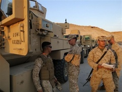 Caption: American armored trucks used on patrol in Anbar province., Credit: Photo courtesy of the Associated Press.
