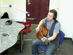 "Caption: Mike Droho performing in studio on KQAL's ""The Live Feed"", Credit: Terese Tenseth"