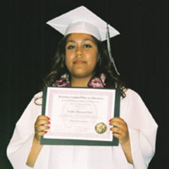 Caption: Claudia Villa with her high school diploma