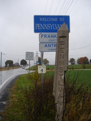 Caption: A mile marker along the Mason-Dixon Line., Credit: Tamara Keith