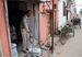 Caption: Lekh Ram weighing newspapers at his shop in Ambala, India. , Credit: Photo by Michael Beebe