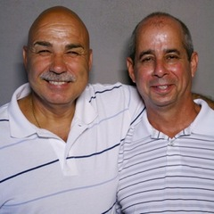 "Retired New York City sanitation worker Angelo Bruno (L) speaks with his former partner, Eddie Nieves (R), about working together on their daily route. <a href=""http://www.prx.org/pieces/52877-storycorps-angelo-bruno-and-eddie-nieves"">Listen Here</a>. Credit:"