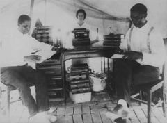 Attorney B.C. Franklin (right) with fellow lawyer I.H. Sears (left) and secretary Effie Thompson in a tent that functioned as their law office following the 1921 Tulsa Race Riot. Credit: The Beryl Ford Collection at the Tulsa City-County Library