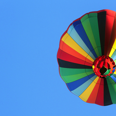 "Credit: <a href=""http://www.shutterstock.com/pic-122931382/stock-photo-hot-air-balloon-over-blue-sky.html"">Shutterstock</a>"