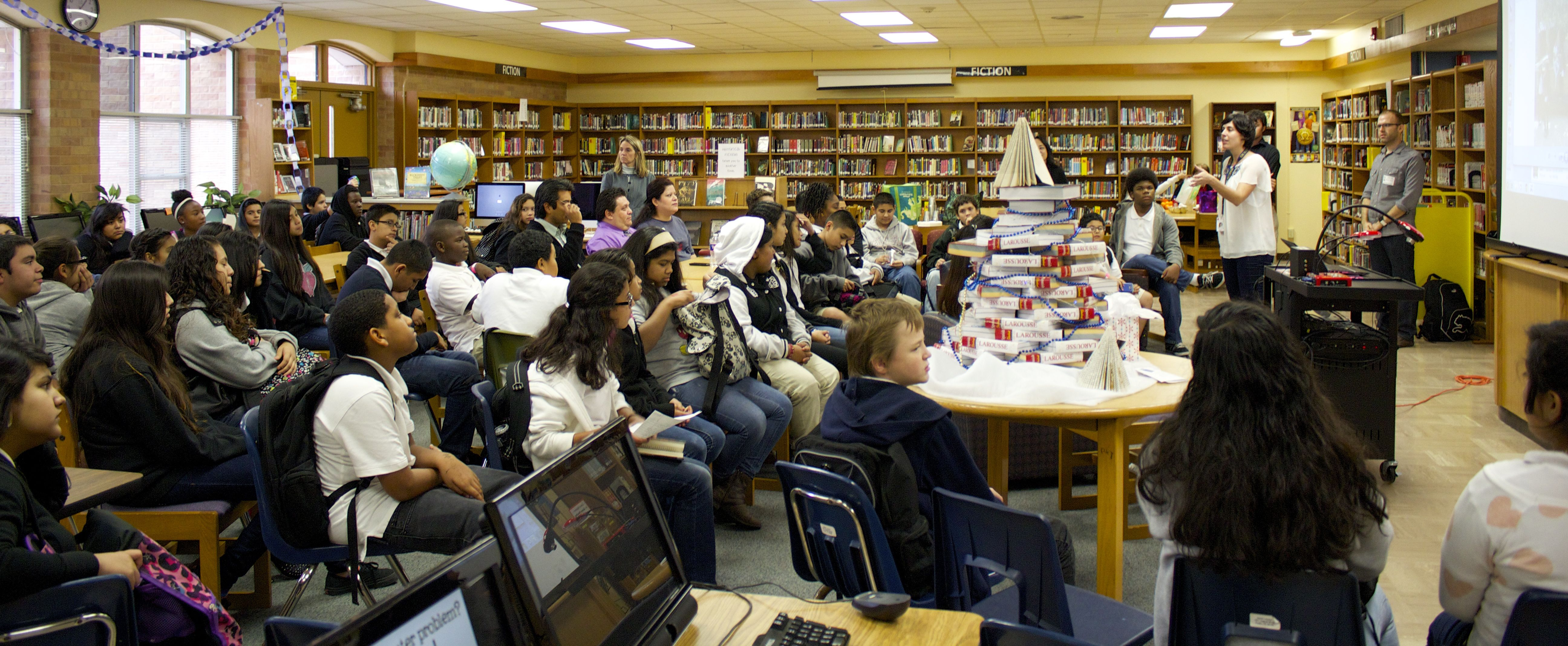 Caption: Ms. Karydas introduces Stories at Martin Middle School Library, Credit: Michelle Mejia