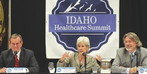 Caption: Former Secretaries of Health and Human Services Mike Leavitt (left) and Kathleen Sebelius participate in a panel discussion moderated by Post Register Editor and Publisher Roger Plothow at the Idaho Healthcare Summit on Tuesday morning. The summit was hel, Credit: Monte LaOrange, Post Register