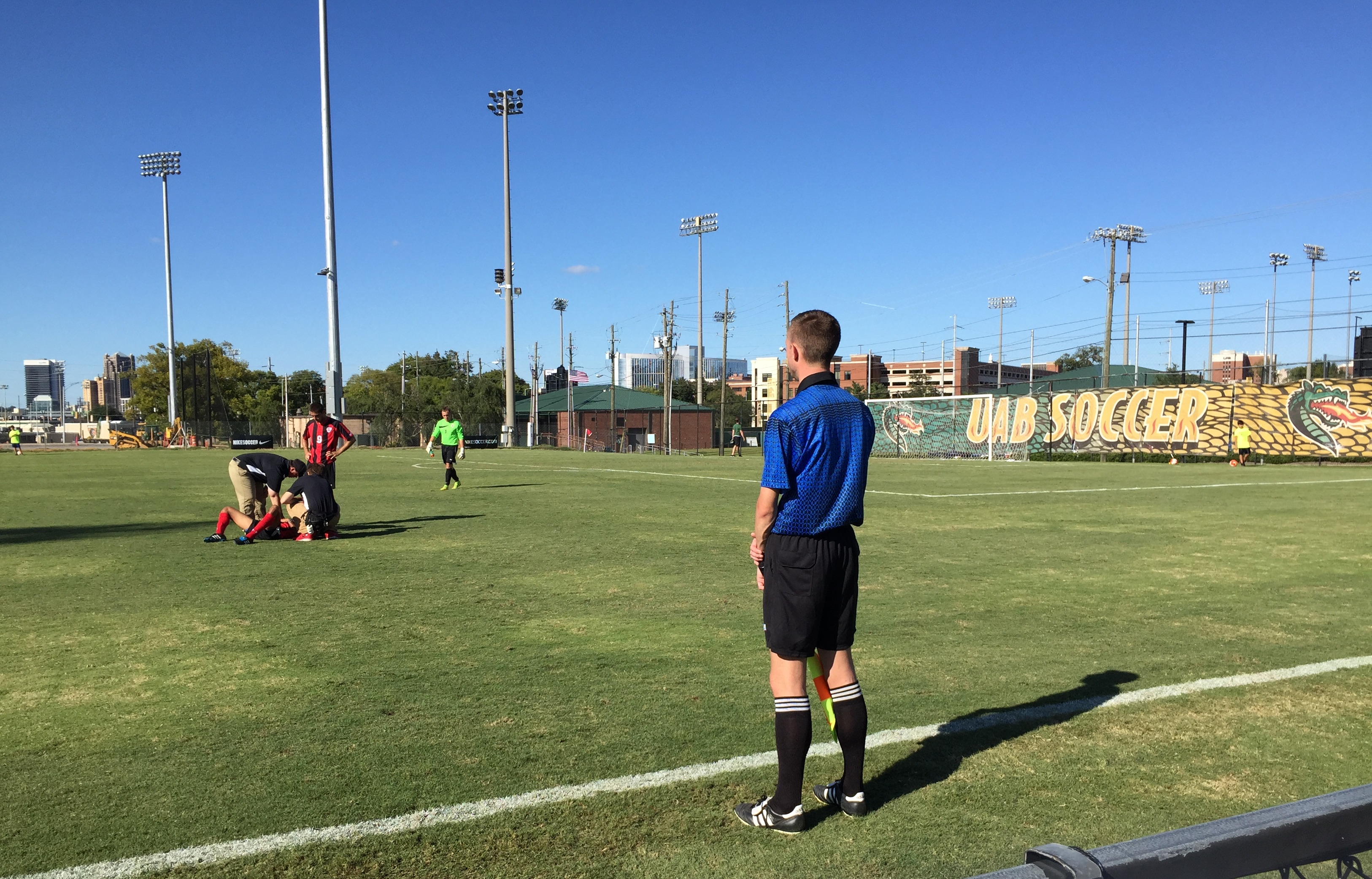 Caption: In addition to balancing academics and athletics, college athletes also face the challenge of injury on the field of play, like this Gardner-Webb soccer player in a game at UAB., Credit: Dan Carsen