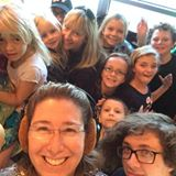 Caption: Katie Stone & some of the KUNM Kids