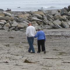Caption: Older couple on the beach in Santa Cruz, CA.