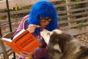 image of Professor Blue eating chips with her dog