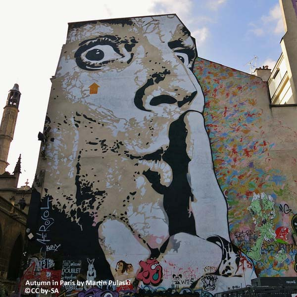 face painted on a wall in paris