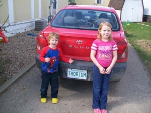 image of kids near a car with Thorium on the license plate